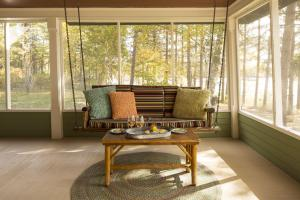Swinging Bench on Porch photos large group family vacation rentals